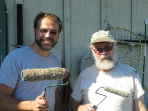 Brennan & volunteer Larry Oggs do another glamour job - paint