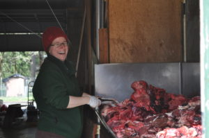 Animal care staff person Meghan prepping meat for the wolves