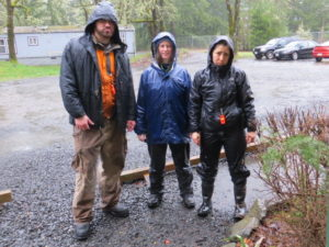 Animal care staff smiling through the rain