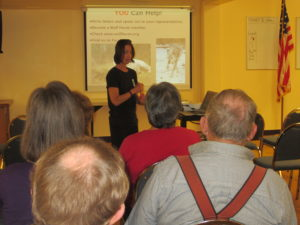 Skie speaking about wolves at Montesano Library