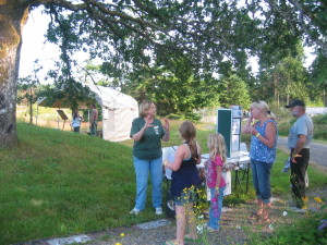 Volunteer Suzanne talks to visitors about prairie plants.