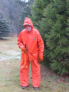 "Volunteer Ron Bond ""enjoys"" pulling scotch broom in the rain."