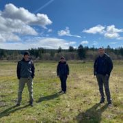 Essential animal care staff Erik Wilber, Pam Maciel and Dan Monn practice safe social distancing while remaining at the sanctuary to care for the wolves.